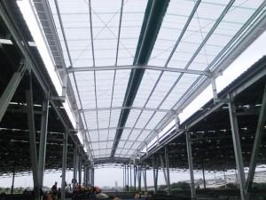 Talang air fiberglasss posisi di dua sisi canopy untuk menyalurkan air hujan ke drainase